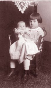 Josephine, about 5, in rocking chair with her new aunt.